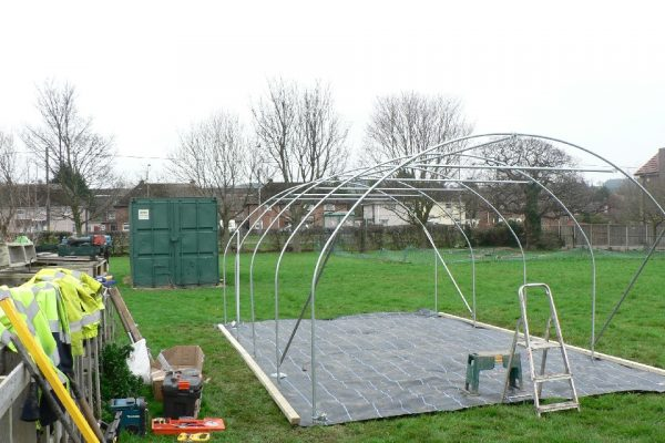 a polytunnel being constructed