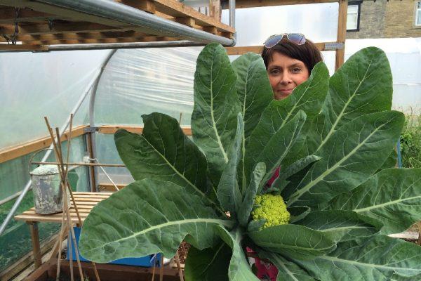 woman holding large cauliflower
