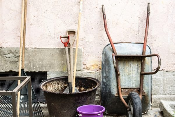 gardening tools against a wall
