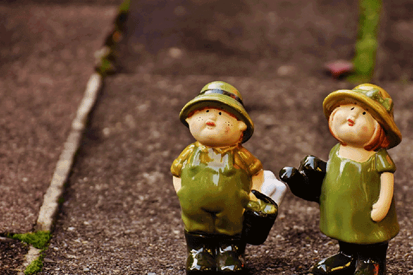 two ceramic garden gnomes looking up