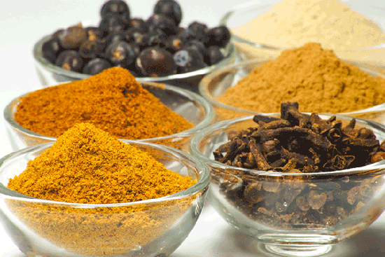 small glass bowls holding spices
