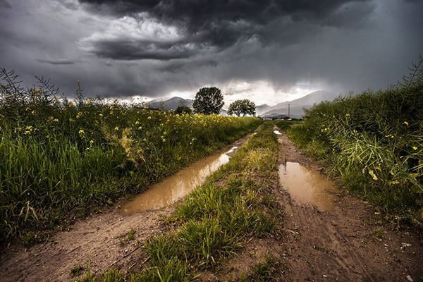 storm clouds and muddy path