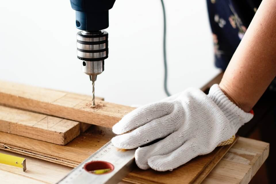 Drilling holes through wood during a DIY project