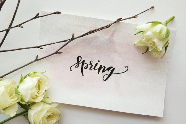 spring written on a piece of paper