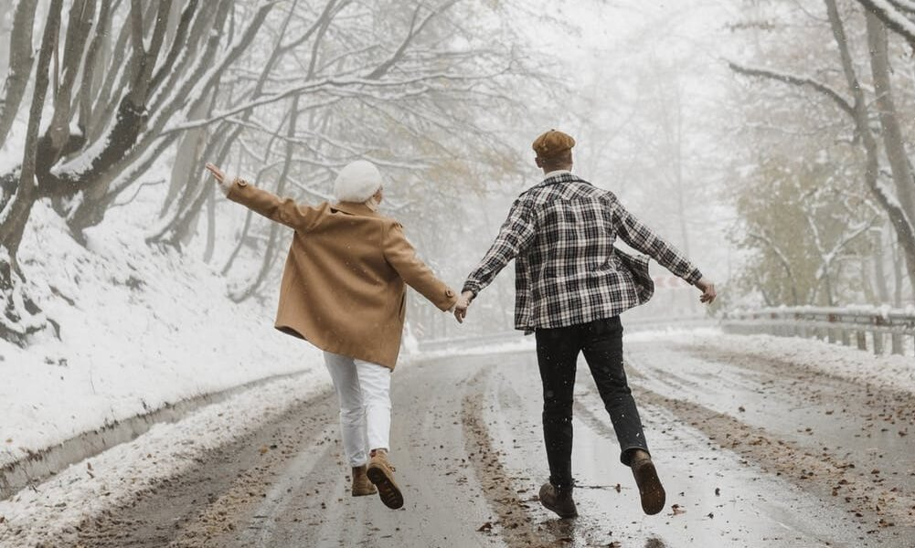 two people walking in the winter